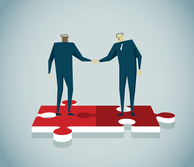 Illustration of two people standing on interlocked puzzle pieces, shaking hands