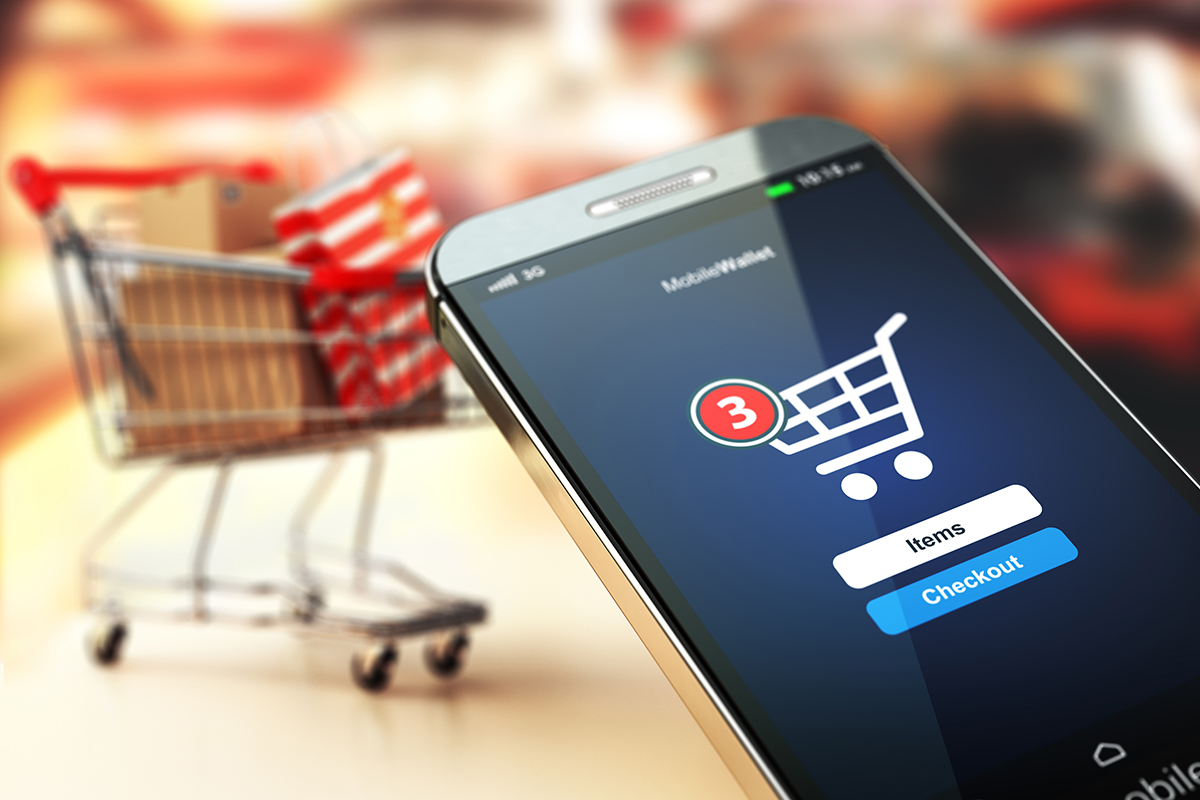 Phone with three items in shopping cart ready to buy